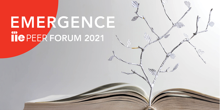 "Hero image showing an open book with a  tree growing out of it. Test reads, ""EMERGENCE: IIE PEER Forum 2021"""