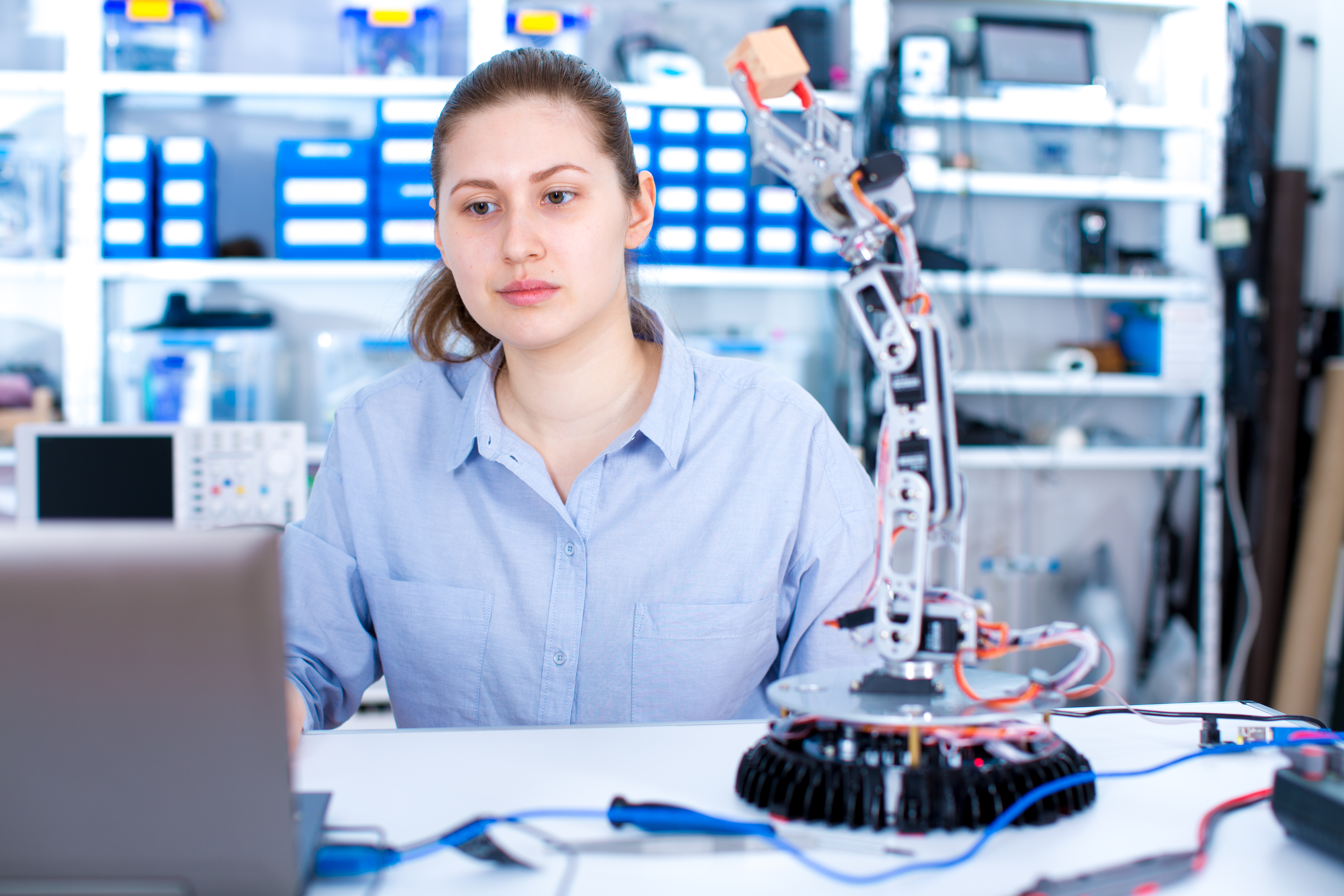 Young woman in robotics laboratory