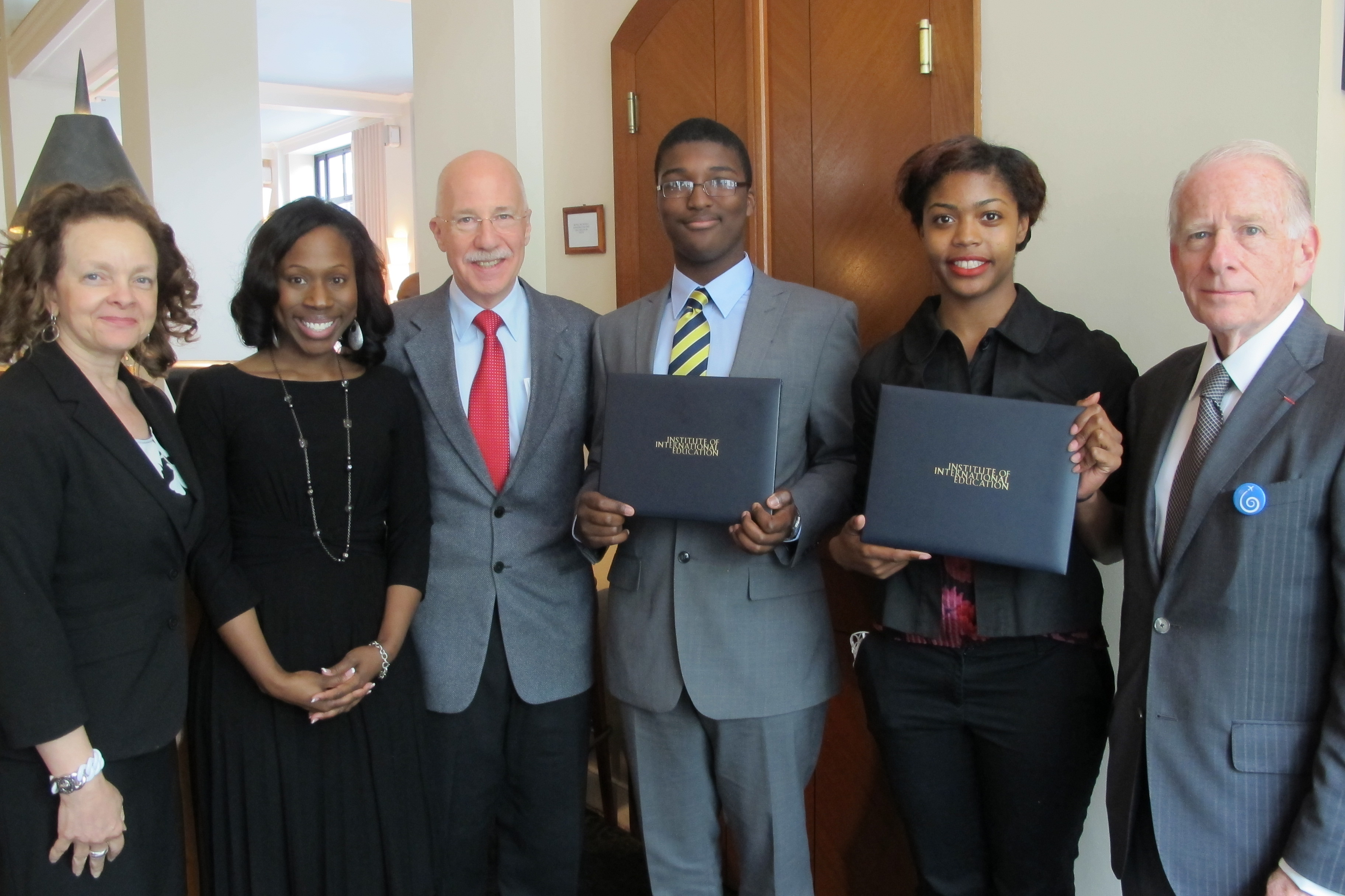 Photo: President and Board Member with young award winners