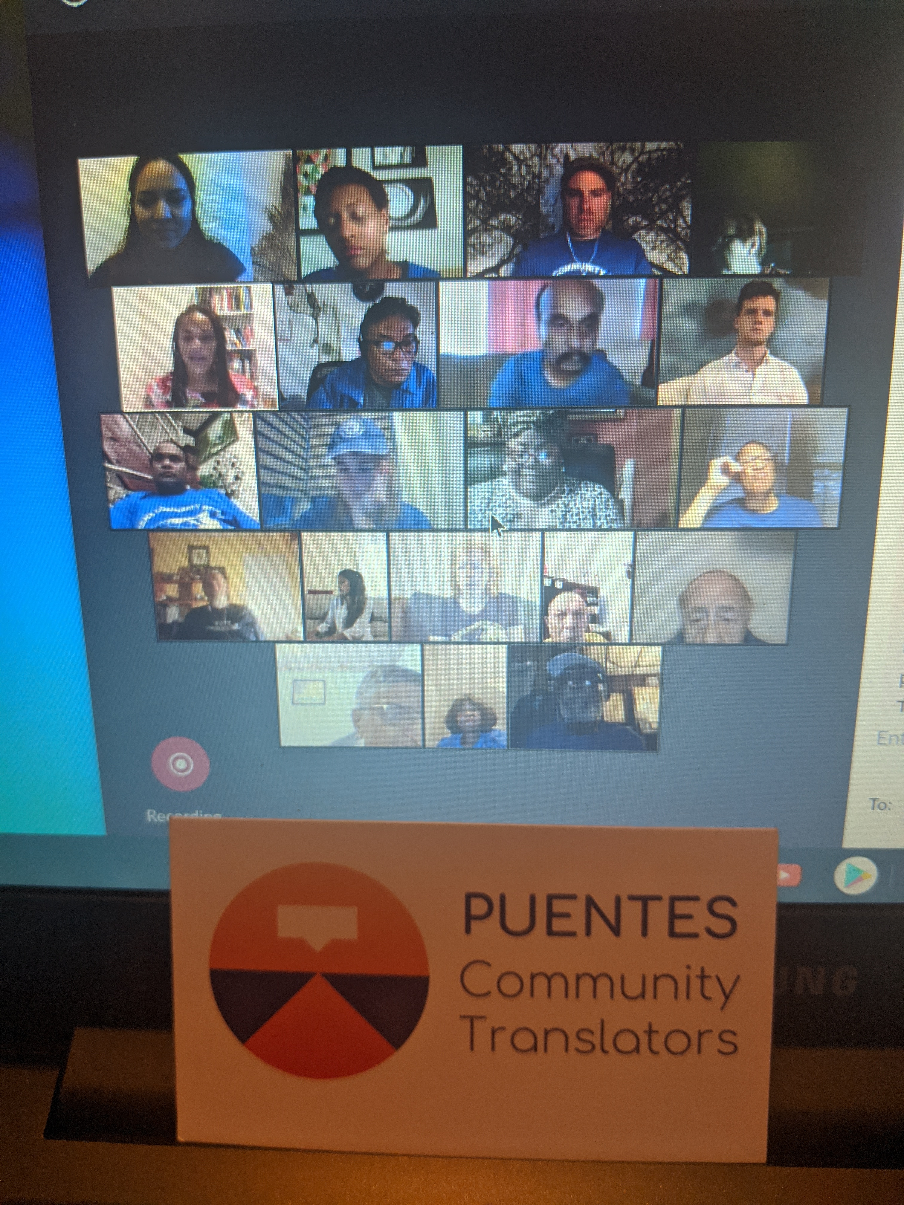 People on Zoom call with Puentes logo  in foreground