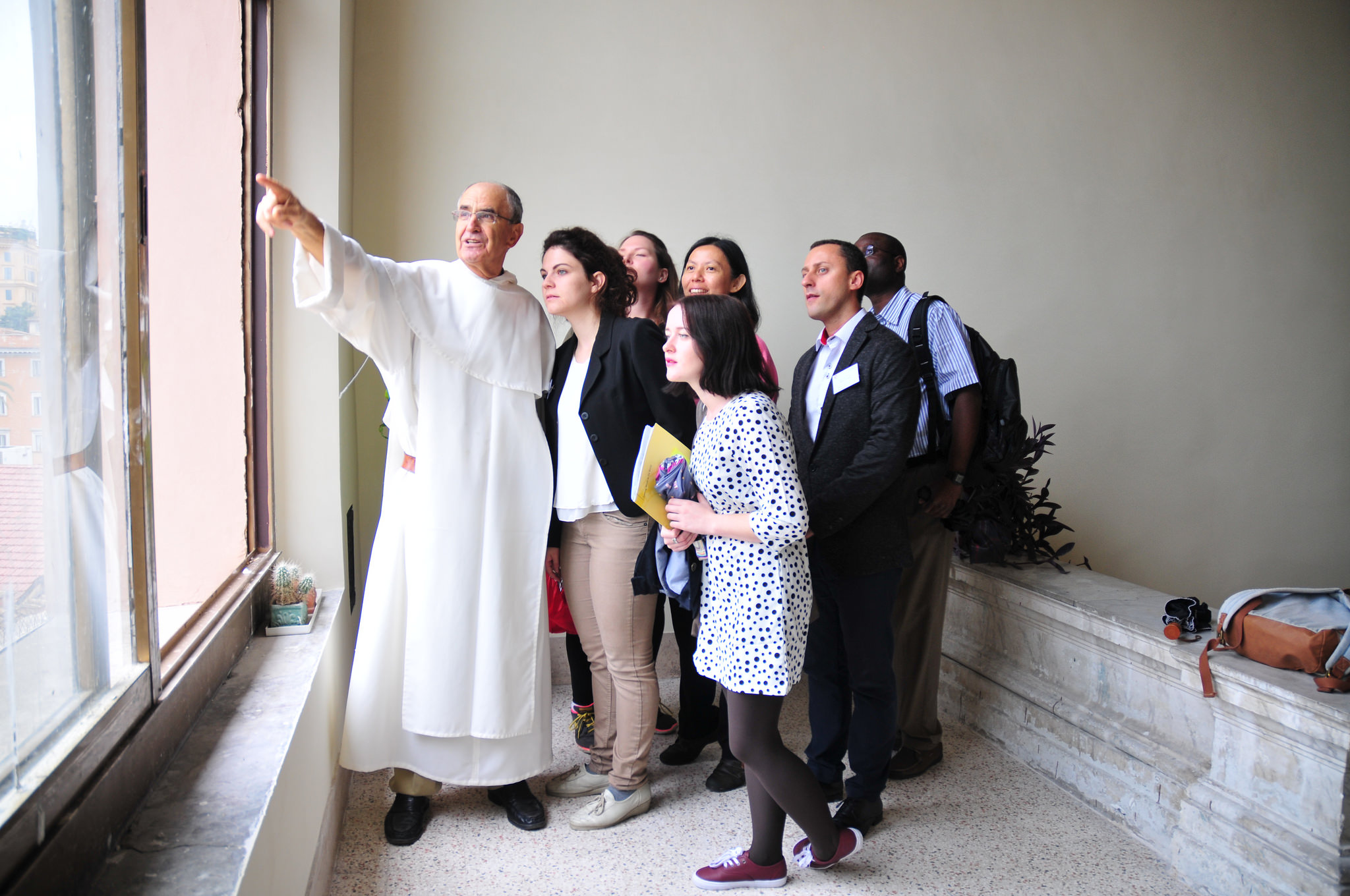 Photo: Priest with a group of professionals