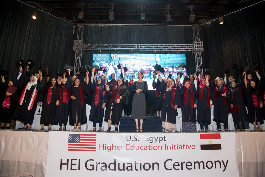 Students on stage at HEI graduation ceremony