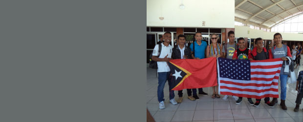 Photo: Students hold Timor-Leste and USA flags