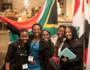 TechWomen pose with South African flag
